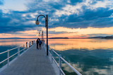 sunset over the transylvania lake in Umbria Italy intense late summer colors in the pier