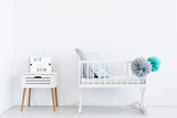 White cradle with pastel pompons - 173989979