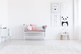 Simple kid's bedroom with posters - 173990120
