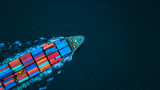 Aerial view from drone, container ship or cargo ship in import export and business logistic. © Kalyakan
