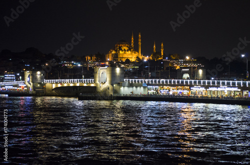 reflected lights in the water and galata bridge in the dark at night Poster