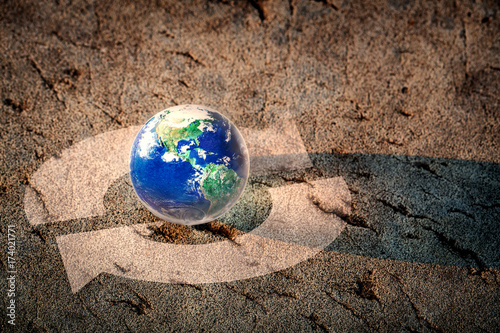Earth and recycling arrows on the floor, Save our world concept, Elements of thi Poster