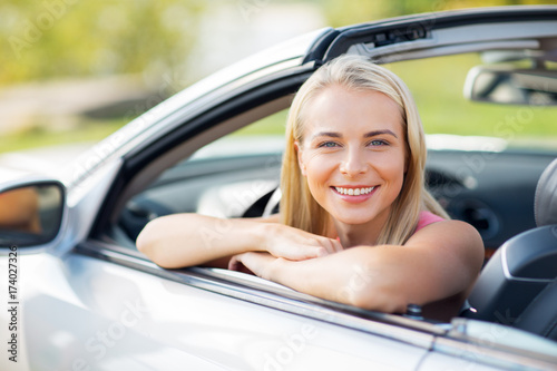 Fridge magnet happy young woman in convertible car