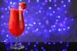 Leinwanddruck Bild - Glass of delicious strawberry daiquiri on table against defocused lights