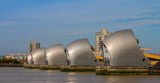 The metallic piers of the Thames Barrier line up, protecting London from flood. - 174044744