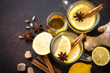 Autumn hot tea with ginger, lemon, honey and spices. Top view. - 174060736