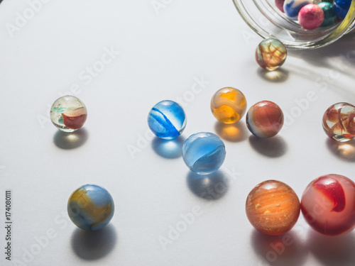 Plakat Colorful Marbles on White Background