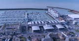 Aerial dolly view of sailing boats in Brighton marina - 174117907