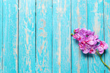 Beautiful fresh flower on wooden table, top view - 174135982