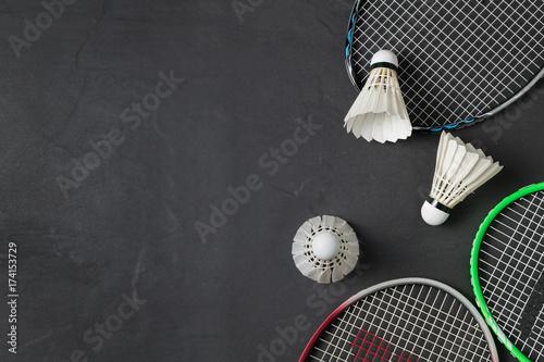 Fototapeta Shuttlecocks and badminton racket on black background.