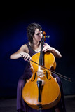 Beautiful girl plays the cello. - 174157109