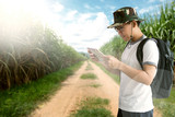 Man is looking map while travel into jungle. - 174170318