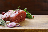 Organic raw meat on a wooden table - 174190331