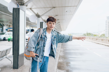 Asian man waiting for taxi at the airport