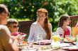 happy family having dinner or summer garden party - 174194363
