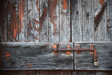 Old shabby doors with bolt and lock - 174204903