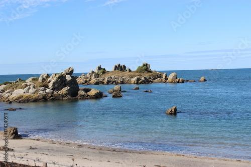 Fotobehang rocher dans la mer
