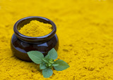 powdered spice, background texture of turmeric - 174246933