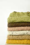 Pile of hand knit clothes - 174255766