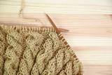 Knitting a woolen sweater - 174256714