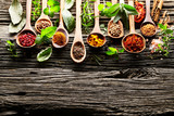 Herbs and spices on a old wooden background - 174260779
