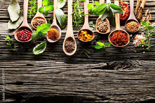 Herbs and spices on a old wooden background