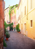 view of old town italian narrow street in Trastevere, Rome, Italy, retro toned