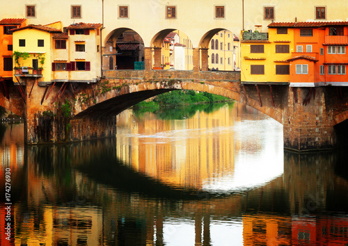 Papiers peints Florence famous bridge Ponte Vecchio with reflection, Florence, Italy, retro toned