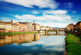 old town, bridges and river Arno reflecting in water at summer day, Florence, Italy, retro toned