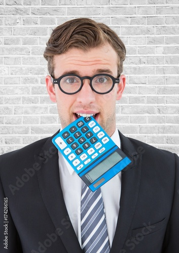 Close up of nerd man with blue calculator in mouth against white - 174286165