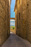 View through the old tuscany street from tuf stone to countryside