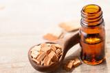 Sandalwood essential oil on the table - 174300338