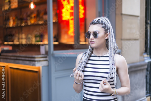 Keuken foto achterwand Kapsalon Happines young woman with braided hair in the street.