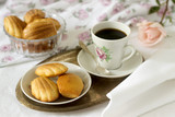 Madeleine, served with coffee. Traditional French pastries. Romantic breakfast. Style ryustik, selective focus. - 174321788