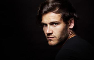 caucasian man wearing  black tshirt and trendy hairstyle © Zdenka Darula