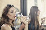 Friends drinking a glass of wine - 174323367