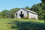 Photo of an old rustic abandoned barn in a rural landscape setting - 174327753