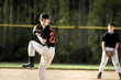 Pitcher Winding Up In Youth Baseball Game