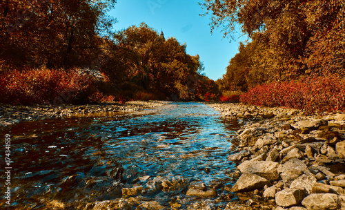 Fall landscape with sky reflection in the river