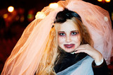 Girl teenager in the image of a dead bride zombie on halloween - 174343736