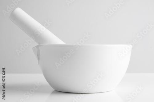 white mortar and pestles on white