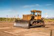 Yellow bulldozer on the construction site