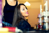 Portrait of a happy woman at the hair salon - 174406378