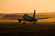 Take off of a passenger aircraft at sunset of the day