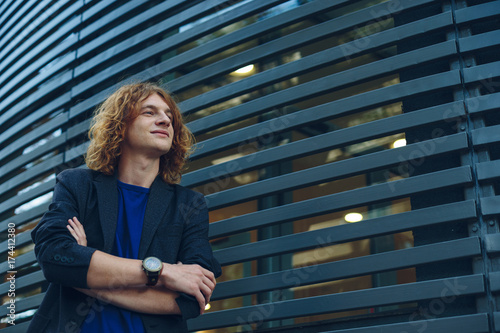 Portrait of red haired man over urban futuristic background