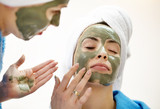 Close-up Portrait of two beautiful looking womans with a facial clay mask. - 174420790