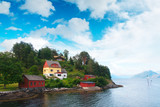 Typical norwegian landscape with red house - 174428770