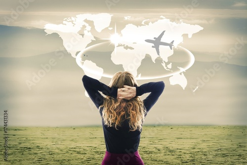 Foto Murales concept of travel, woman with map world and plane