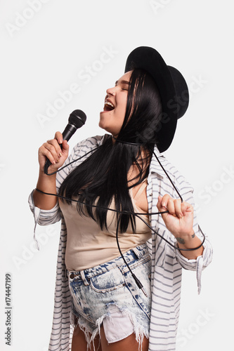 Póster sexy women in a hat with  microphone