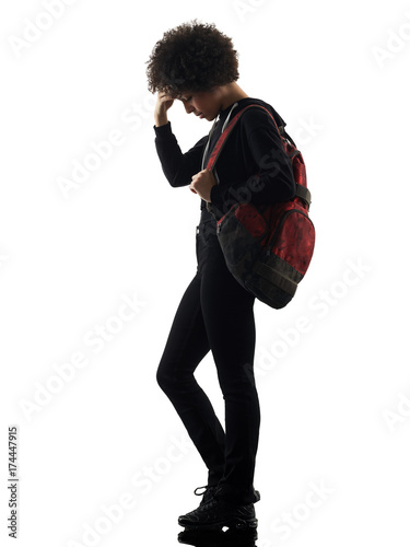 one mixed race african young teenager girl woman standing sadness in studio shadow silhouette isolated on white background